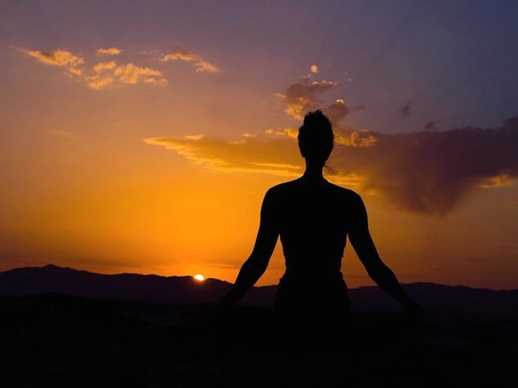 Female Silhouette Yoga Pose at Sunset, Morocco