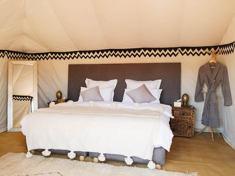 Luxury Berber Desert Camp Bedroom, deluxe double bed, pillows, bedside cabinet and mirror