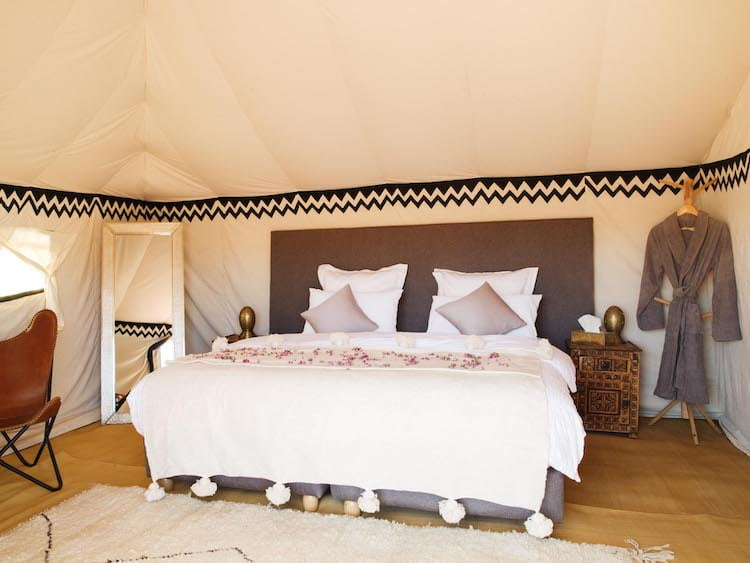 Luxury Berber Desert Camp Bedroom, deluxe double bed, sheets, blankets, pillows, bedside cabinet and mirror
