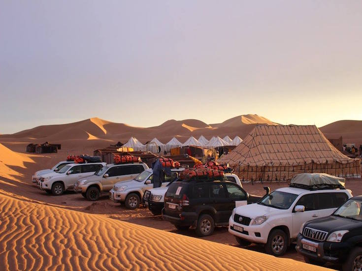 4x4 Tourist Vehicles Parked at Yoga Camp Retreat in the Sahara, Desert, Morocco