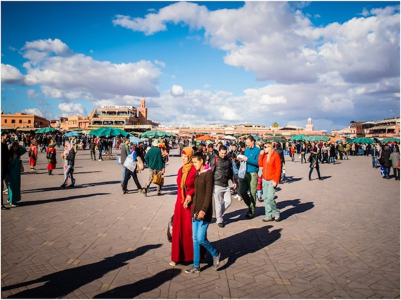 Tourists and locals gathering in Marrakech's main square, Jemaa el-Fnaa