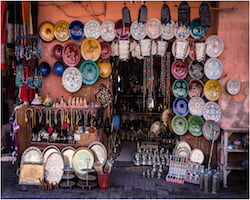 Market stall in the Medina souk in Marrakech, Morocco selling decorative African plates