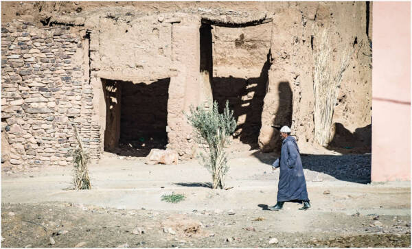Beldi Tribesman Walking through Tamegroute Village, located in the Draa River Valley, Southern Morocco