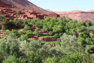 Traditional mud brick Berber Village nestled in the Atlas Mountains